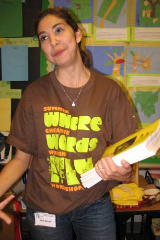 Lori Duron passes out anthologies to the proud, young authors.