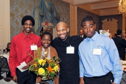 "Jeremy with past members Ebonne and Jordan, and Meta-Four coach ""Outspoken Bean"""