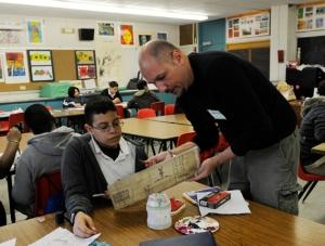 Artist Nicola Parente guides his student through an art lesson