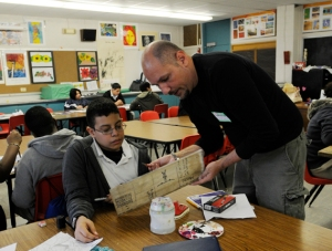Artist Nicola Parente guides his student through an art lesson